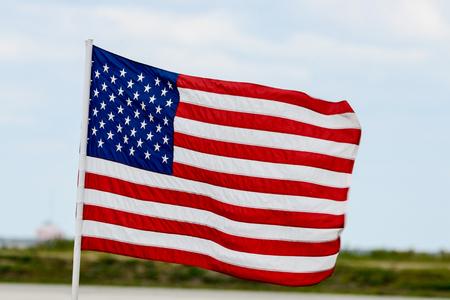 American Flag flying high on a the windy day 版權商用圖片