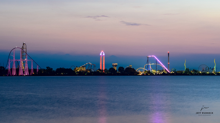 Ceder point amusement park just before sunrise from the shores of Sandusky Stock Photo