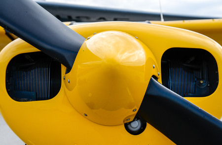 colorful plane nose showing the propeller sitting still