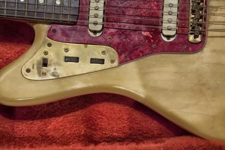 beaten up: old beaten up classic fender jaguar guitar Stock Photo