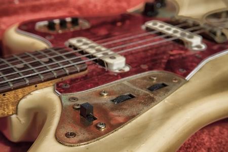 beaten up: old beaten up classic guitar Stock Photo