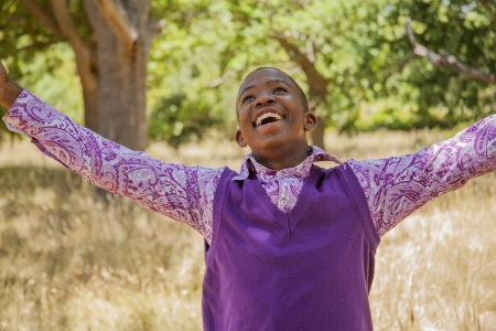African teenage boy. outdoors with bright clothes Stock Photo