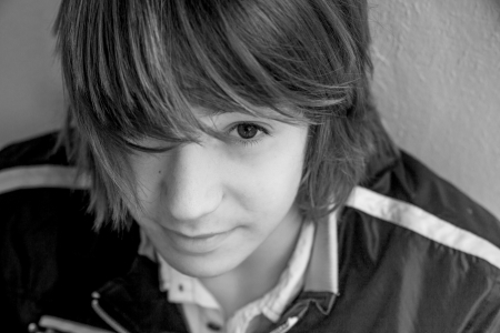 close up of teen boy with long hair