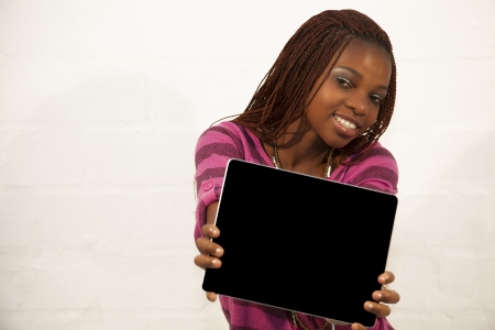 African Woman Holding a Blank black Sign against white background Stock Photo