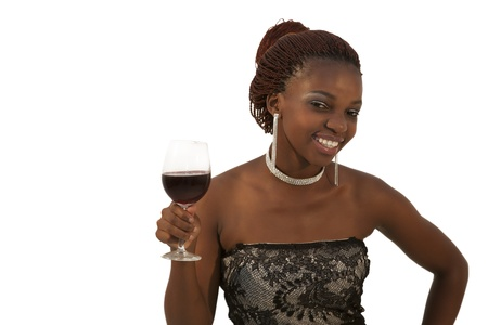 Beautiful young african woman holding a glass of red wine against white background photo