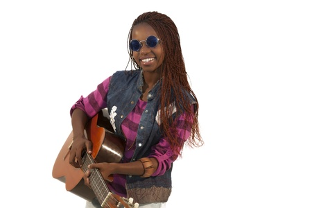 Beautiful african woman playing guitar against white background photo