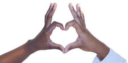 woman black background: Two hands making a heart shape on white background