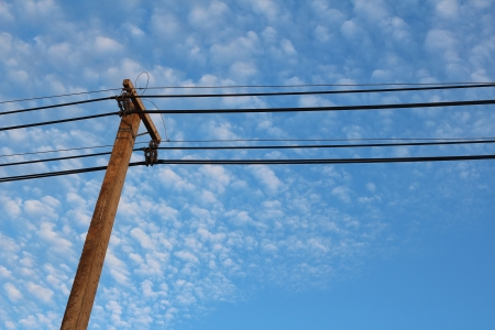 electricity pole in blue sky photo