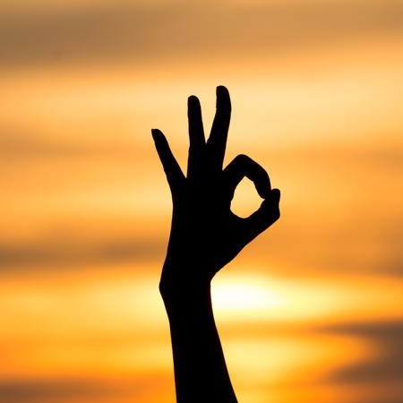 handsignal: Ok hand sign silhouette