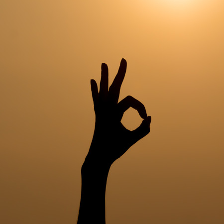 handsignal: Ok hand sign silhouette.