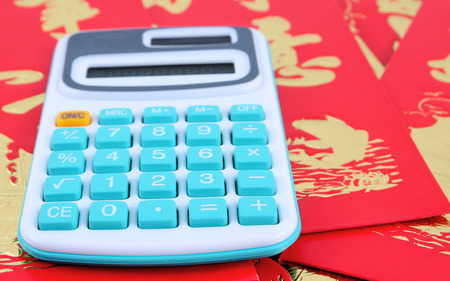 calculator chinese: The calculator is placed on amount of the Chinese New Year red envelopes.