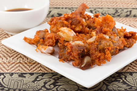 tendones: Tendones de cerdo fritos con salsa de negro Foto de archivo