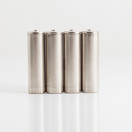 aa: silver AA batteries isolated on white.