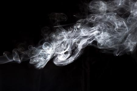 cigar shape: Smoke on black background. Stock Photo