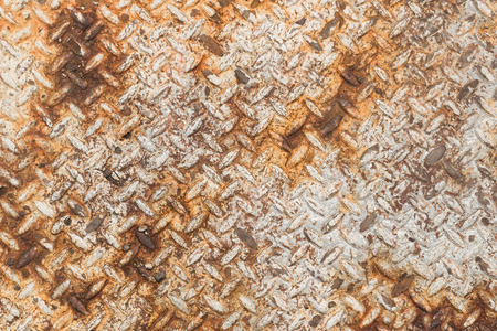 Texture of rusty old diamond plate metal. photo