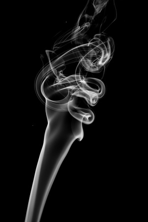 cigar shape: Abstract white smoke on black background. Stock Photo