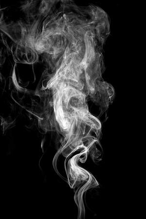 cigarettes: Abstract white smoke on black background. Stock Photo