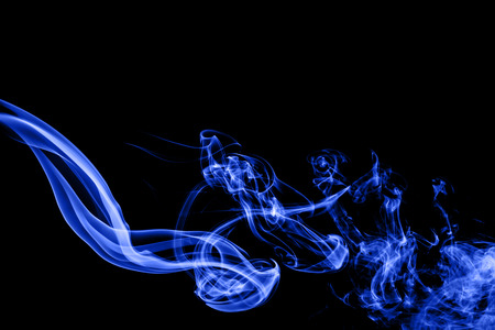 blue smoke: Abstract blue smoke on black background. Stock Photo
