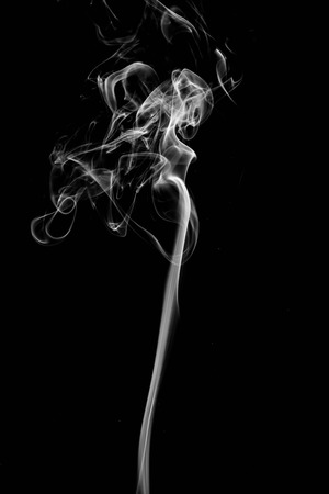 cigar shape: Abstract white smoke on black background. Stock Photo