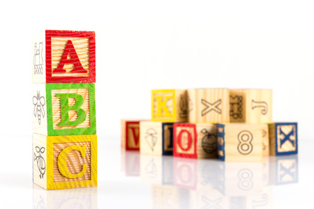 studio b: ABC wooden blocks on white background. Foto de archivo