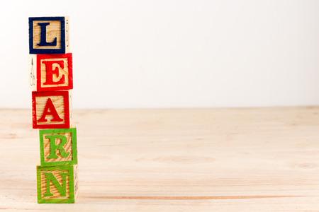 spell: Alphabet Block spell the word learn.