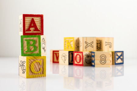 building tool: ABC wooden blocks on white background. Stock Photo