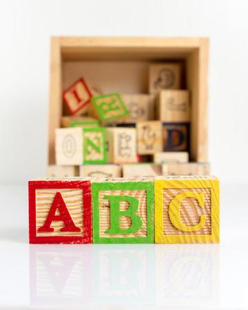 letter c: ABC wooden blocks on white background. Stock Photo