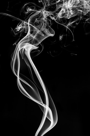 black smoke: Abstract white smoke on black background. Stock Photo