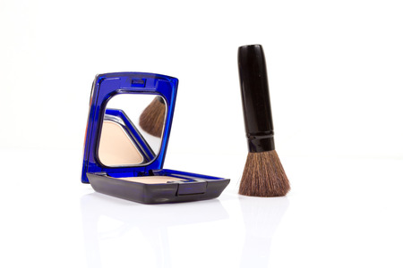 colorant: closeup of brush and face powder isolated on white.