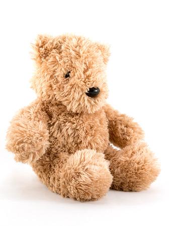Fluffy teddy bear wearing a red Santa hat. Banco de Imagens