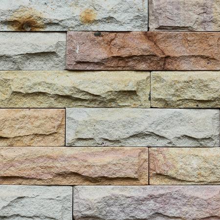 クローズ アップ現代石レンガの壁が浮上しました。 写真素材