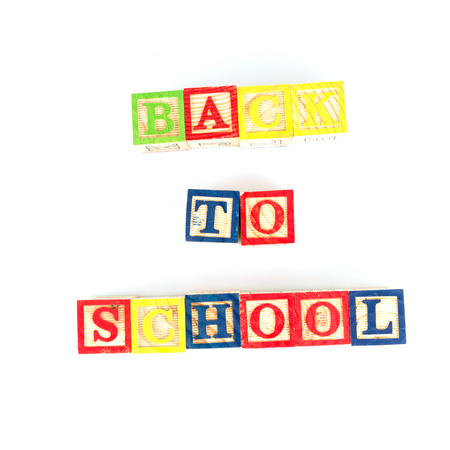 school form: Wooden alphabet blocks on white background arranged to form the words, back to school
