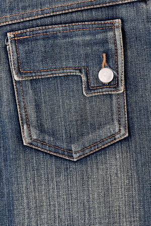 metallic button: Close up of a pocket jeans with metallic button