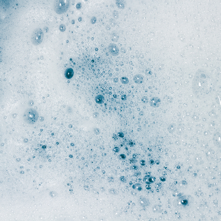 Bubble caused by washing as background. Stock Photo