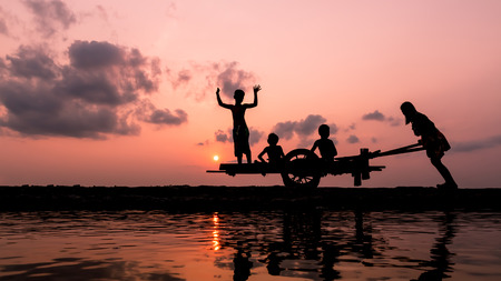 Silhouette of family after hard work. Stock Photo