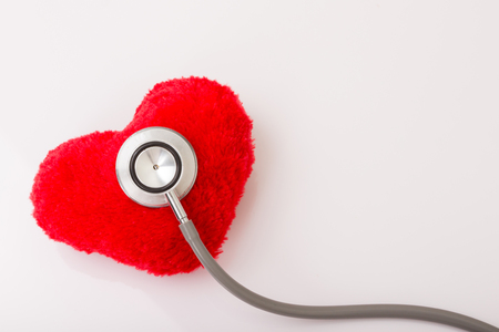 Stethoscope and heart, isolated on white background Stock Photo