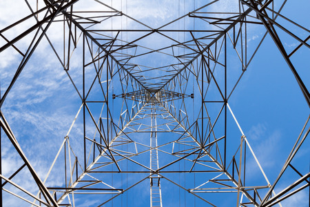 amperage: Electric power transmission with blue sky.
