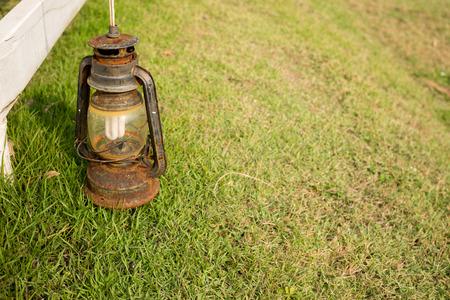 energized: Garden lamp on grass.