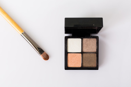 Eye shadow with brush on white background.