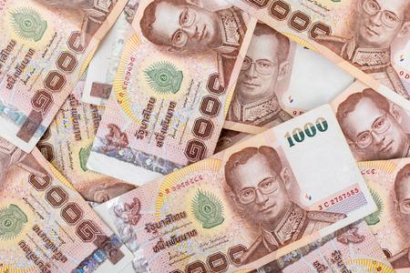 coin bank: Thai money 1000 baht , thai bank note background.