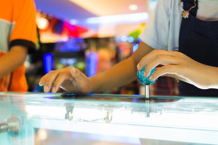 Close up hand control joystick of arcade,Vintage tone.