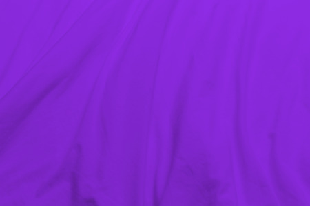 creased: creased purple cloth material fragment as a background. Stock Photo