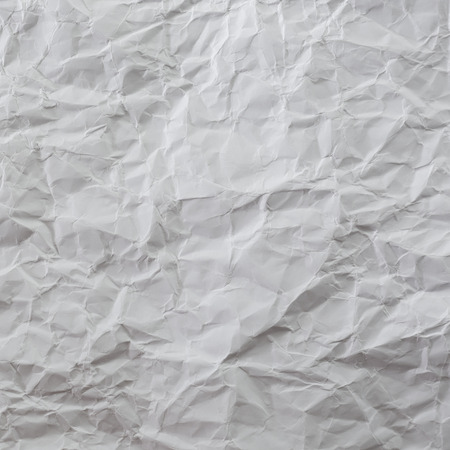 wrinkly: White creased paper background texture.
