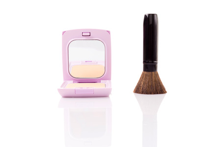 colorant: closeup of brush and face powder isolated on white