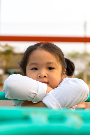 Asian girl is playing on the playground