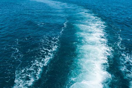 wake: Sea wake behind large ship.