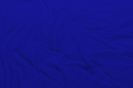 creased: creased blue cloth material fragment as a background.