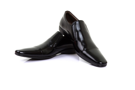 men s feet: black shoes isolated on white background. Stock Photo