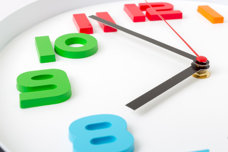 Colorful clock or time abstract background. white clock with red and black needles.