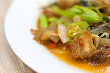 Close up of stir-fried pork and basil.